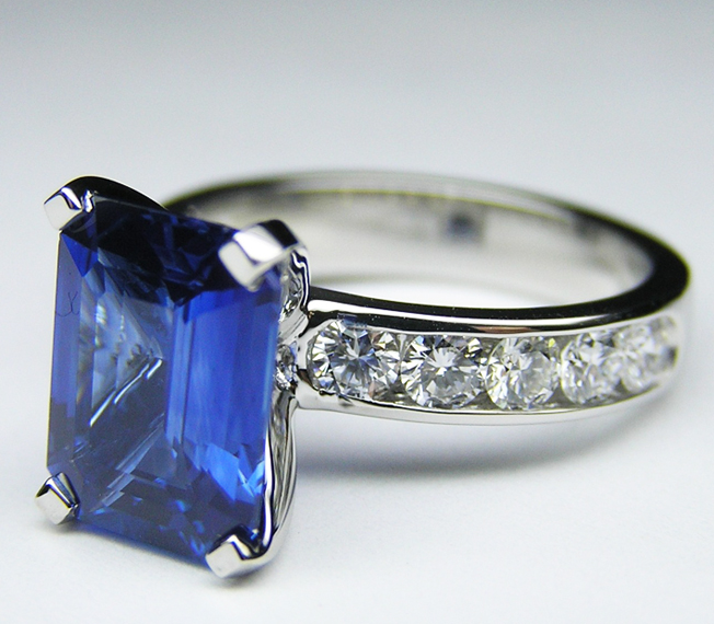 2.8 Carat Blue Sapphire Emerald Cut Ring with Channel Set Diamond Band