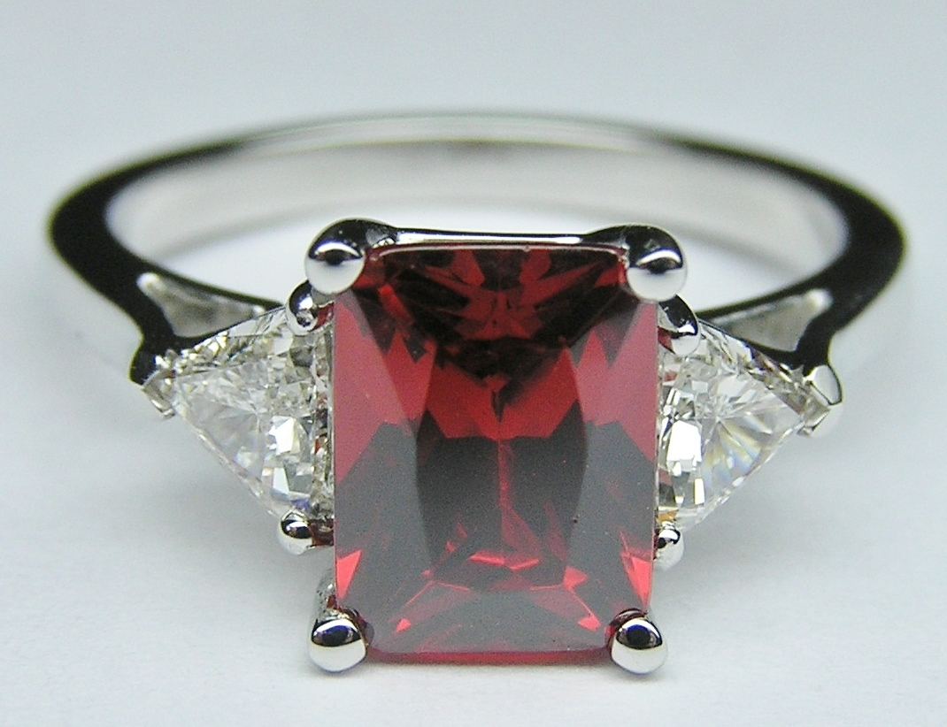 Radiant Red Garnet with Trillion Diamonds sides in 14K White Gold