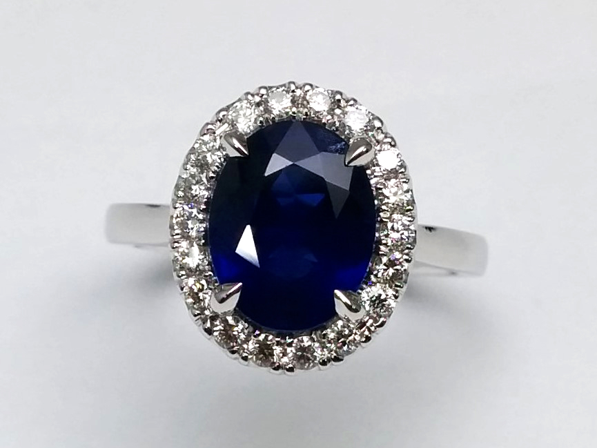 Oval Halo Blue Sapphire Ring in 14k White Gold
